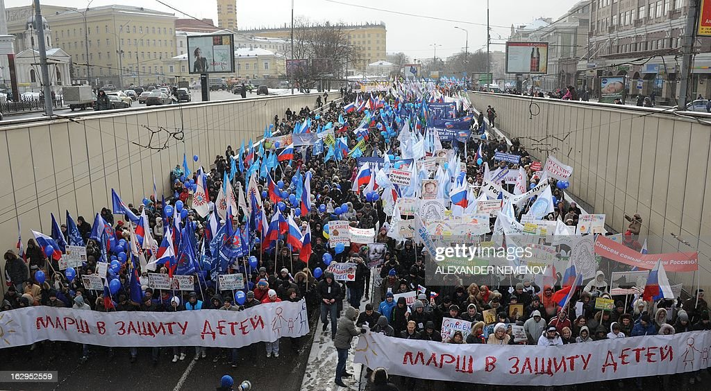 Activists from pro-Kremlin children's advocacy groups march through Moscow on March 2, 2013 to call on authorities to ban all foreign adoptions and demand the return of an adopted boy whose brother died in Texas. The banner reads 'The March for Protection of the Children'.