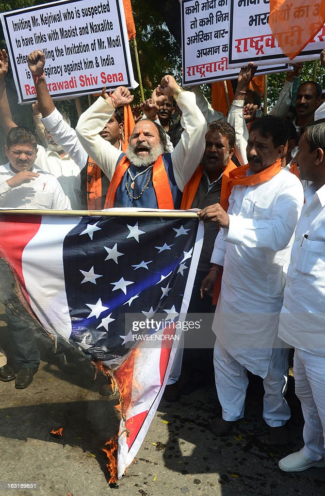 Activists from Rashtrawadi Shiv Sena burn the US flag during a protest against the US government not issuing a visa for India's Gujarat state chief minister Narendra Modi, who was scheduled to deliver an address during the Wharton India Economic Forum to be held in Philadelphia, in New Delhi on March 6, 2013. Modi, who was denied the visa, will deliver the keynote address through video conference, the organisers announced.