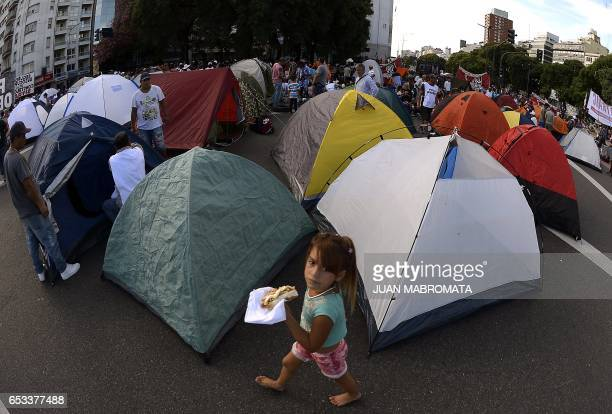 TOPSHOT Activists from social organizations camp on 9 de Julio avenue in front of the Social Development Ministery protesting against the economy...