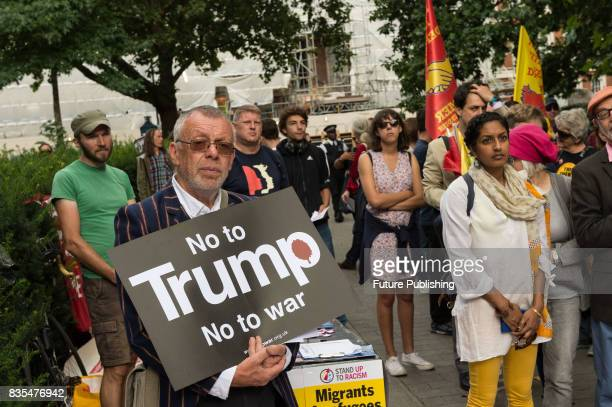 Activists from Stand Up To Trump gather outside the US Embassy on August 19 2017 in London England AntiTrump protest against Donald Trump's politics...