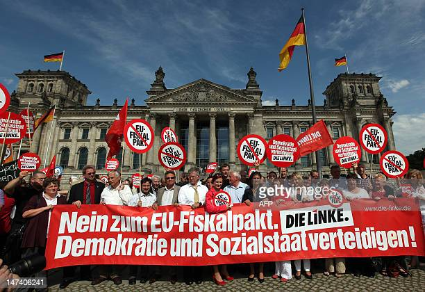 Activists from the antiglobalization group Attac and members of the Die Linke leftwing party hold a banner reading 'No to the EU fiscal pact Let's...