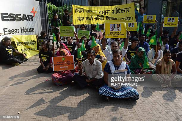 Activists from the environmental group Greenpeace and local farmers from Madhya Pradesh state sit outside the headquarters of India's Essar Group...