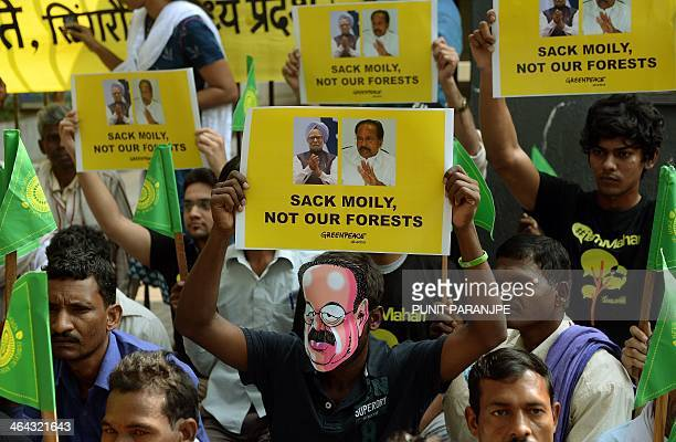 Activists from the environmental group Greenpeace and local farmers from Madhya Pradesh hold placards outside the headquarters of India's Essar Group...
