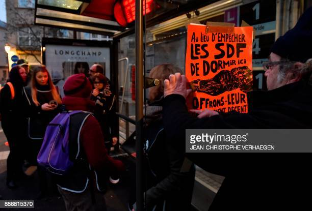 Activists from the Fondation Abbe Pierre foundation take part in a national action in Metz eastern France on December 6 to highlight the use of...