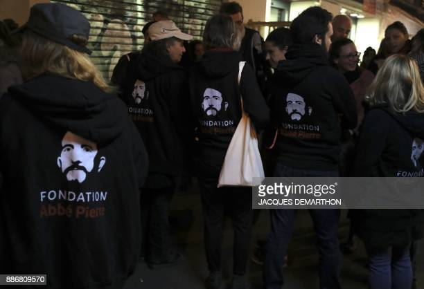 Activists from the Fondation Abbe Pierre foundation take part in an action in Paris on December 6 to highlight the use of 'antihomeless devices'...