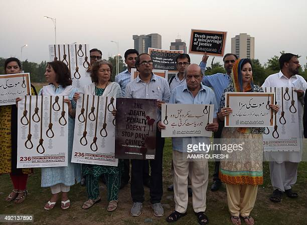 Activists from the Human Rights Commission of Pakistan carry placards during a demonstration to mark International Day Against the Death Penalty in...