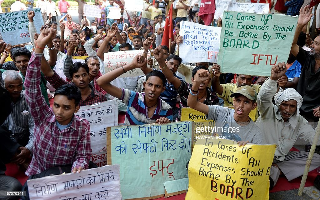 Activists from the Indian Federation of Trade Unions, Communist trade union workers and factory workers shout slogans against state and central government policies that they say negatively impact workers during a protest on International Labour Day in New Delhi on May 1, 2014. International Labour Day is marked globally on May 1. AFP PHOTO/RAVEENDRAN