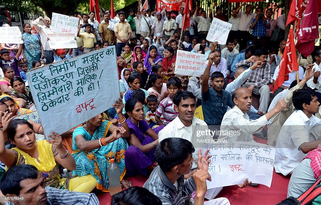 Activists from the Indian Federation of Trade Unions, Communist trade union workers and factory workers hold placards during a protest against state and central government policies that they say negatively impact workers on International Labour Day in New Delhi on May 1, 2014. International Labour Day is marked globally on May 1. AFP PHOTO/RAVEENDRAN