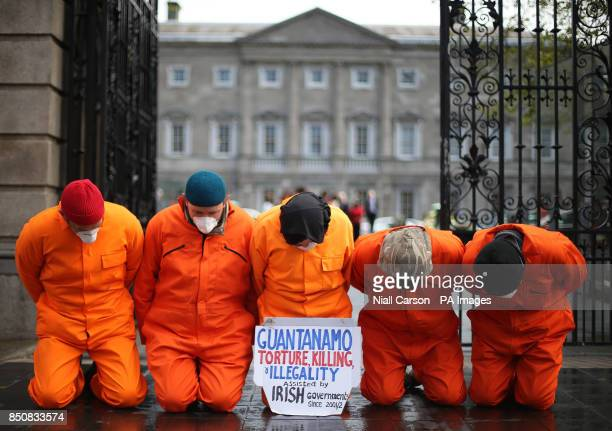 Activists from the Irish Anti War Movement take part a protest at Leinster House in Dublin calling on the closure of Guantanamo Bay detention centre...