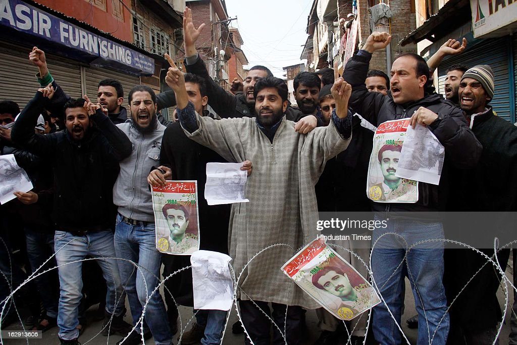 Activists from the Jammu and Kashmir Libration Front (JKLF) shouting slogans demanded the return of Afzal Guru's and Maqbool Bhat's mortal remains to his family during a protest, on March 1, 2013 in Srinagar, India.