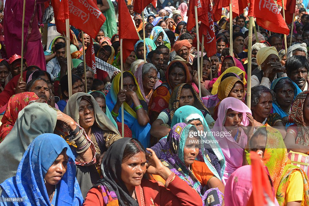 Activists from the National Federation of Indian Women, Aganwadi Teachers, All India Network of Sex Workers, and farmers gather during a protest against the Congress-led UPA government as they demand entitlement for universal old age pension in New Delhi on March 6, 2013. More than 100 social organisations from across the country gathered in the capital to form a 'pension parishad', seeking addressal of universal pension for elderly people. AFP PHOTO/RAVEENDRAN