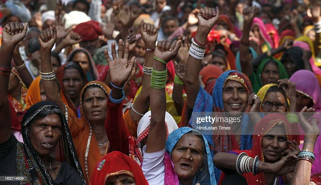 Activists from the National Federation of Women, Aganwadi Teachers, All India Network of Sex Workers, and farmers gather during a protest against the Congress-led UPA government as they demand entitlement for universal old age pension on March 6, 2013 in New Delhi, India. More than 100 social organisations from across the country gathered in the capital to form a 'pension parishad', seeking addressal of universal pension for elderly people.