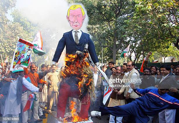 Activists from the Nationalist Congress Party burn an effigy of US President George Bush and shout antiUS slogans during a demonstration against the...