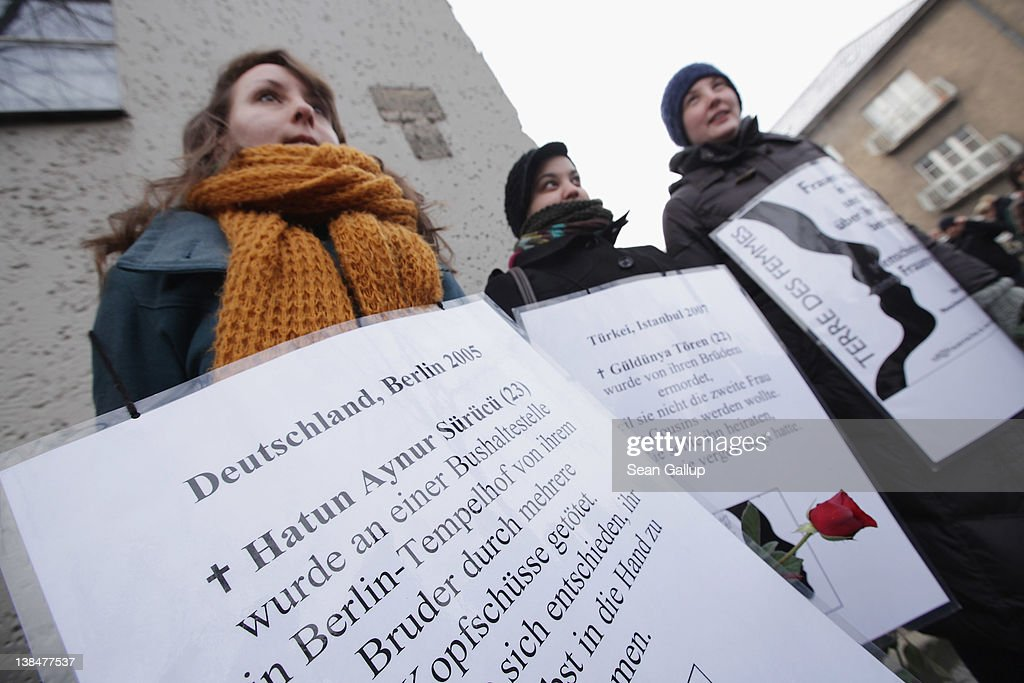 Activists from the organization 'Terre des Femmes' gather at the memorial to Hatun Surucu on the 7th anniversary of her murder near the site where Surucu was killed on February 7, 2012 in Berlin, Germany. Surucu, a Berlin-born daughter of Kurdish immigrants, was shot in the head and killed by her youngest brother Ayhan Surucu in an honour killing in 2005. Hatun had been forced into marriage at the age of 16 and later fled back to Berlin, where she moved into her own apartment, pursued technical training and disbanded elements of her conservative, Kurdish upbringing. Two other brothers accused of the murder were aquitted and received with open arms by their siblings upon their release. Honour killings are a consistant phenomenon among conservative members of Germany's large Turkish and Kurdish communities, with an average of several dozen murders committed every year.