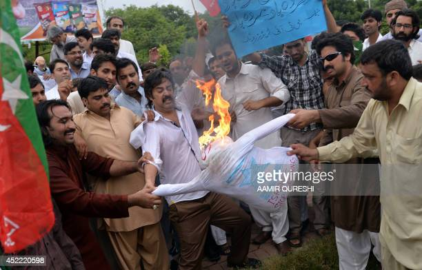 Activists from the Pakistan TehreekeInsaf or Movement for Justice party torch an effigy of Israeli Prime Minister Benjamin Netanyahu as they shout...