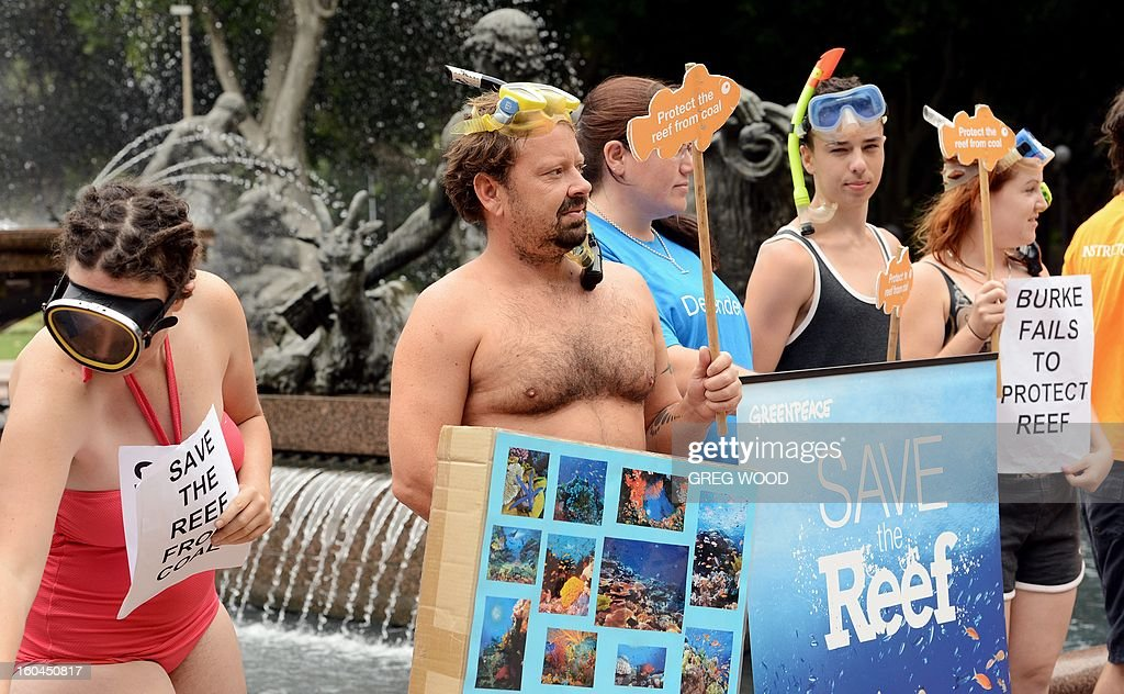 Activists from the 'Protectors of the Reef' collective display placards alongside the Archibald Fountain in central Sydney during a protest in support of Australia's Great Barrier Reef on February 1, 2013. Australia insisted on February 1, that protecting the Great Barrier Reef was a top priority, but conservationists WWF said not enough had been done to prevent UNESCO deeming it a world heritage site 'in danger'. AFP PHOTO / Greg WOOD