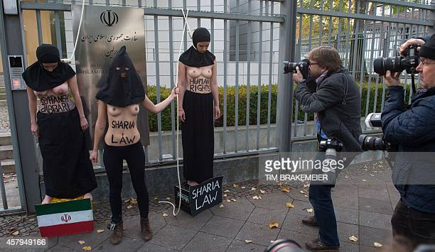 Activists from the women rights organization FEMEN perform a protest in front of the Iranian embassy in Berlin on October 27 2014 The women protested...