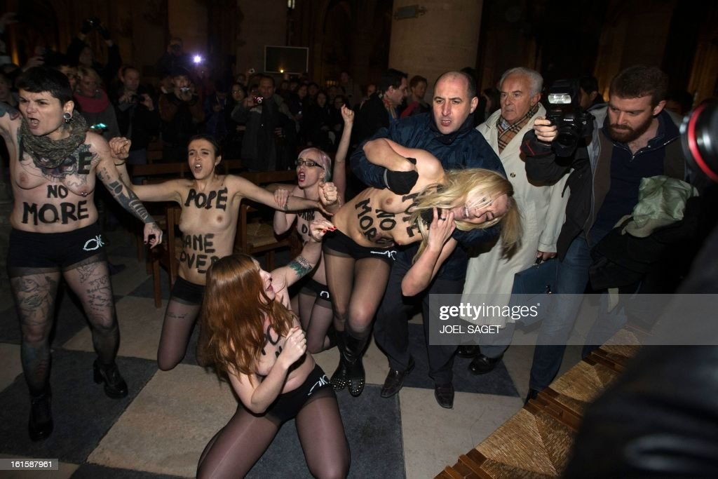 Activists from the women's rights organisation Femen are evacuated as they protest in Notre-Dame de Paris Cathedral in Paris February 12, 2013. According to activists, the protest was organized to celebrate the resignation of Pope Benedict and the French parliament s decision to approve a draft law allowing same-sex marriage.