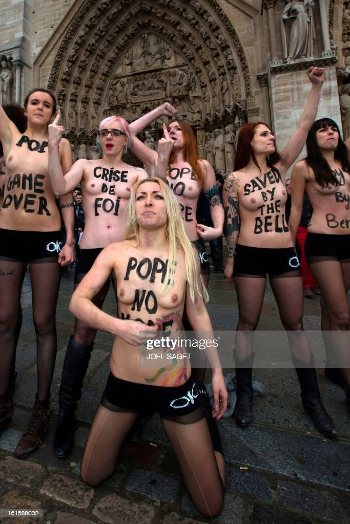 Activists from the women's rights organisation Femen, including Inna Shevchenko (front), protest in front of Notre-Dame de Paris Cathedral in Paris February 12, 2013. According to activists, the protest was organized to celebrate the resignation of Pope Benedict and the French parliament s decision to approve a draft law allowing same-sex marriage. AFP PHOTO JOEL SAGET