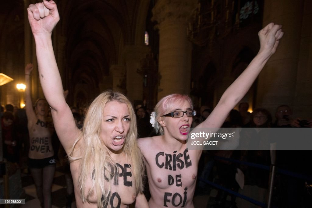 Activists from the women's rights organisation Femen protest in Notre-Dame de Paris Cathedral in Paris February 12, 2013. According to activists, the protest was organized to celebrate the resignation of Pope Benedict and the French parliament s decision to approve a draft law allowing same-sex marriage.