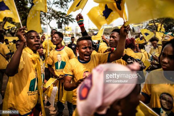 TOPSHOT Activists gather ahead of the address of the leader of the Angolan opposition party CASACE Abel Chivukuvuku at an electoral rally in Luanda...