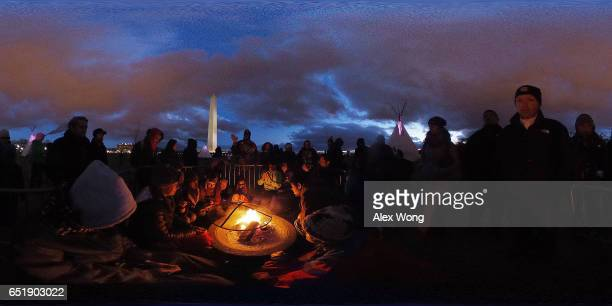 Activists gather around a sacred fire at the ground of Washington Monument after a day of protest March 10 2017 in Washington DC The Standing Rock...