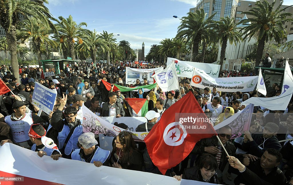 Activists gather for a global anti-capitalist event to demand a more just world order in the center of Tunis after the opening of the World Social Forum (WSF) on March 26, 2013. More than two years after the Jasmine revolution, tens of thousands of people are expected for the WSF, dubbed the forum of 'dignity', a watchword of the Tunisian uprising that inspired revolts across the Arab world.