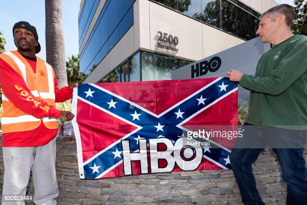 Activists gather in front of HBOs offices in Santa Monica to protest the new HBO series Confederate Santa Monica California on August 12 2017 The...