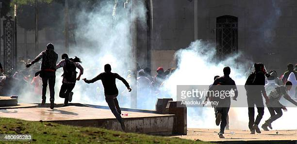 Activists gather in front of the Cairo University to protest the criminal court in Minya condemned 528 Morsi supporters to death on March 26 2014 in...