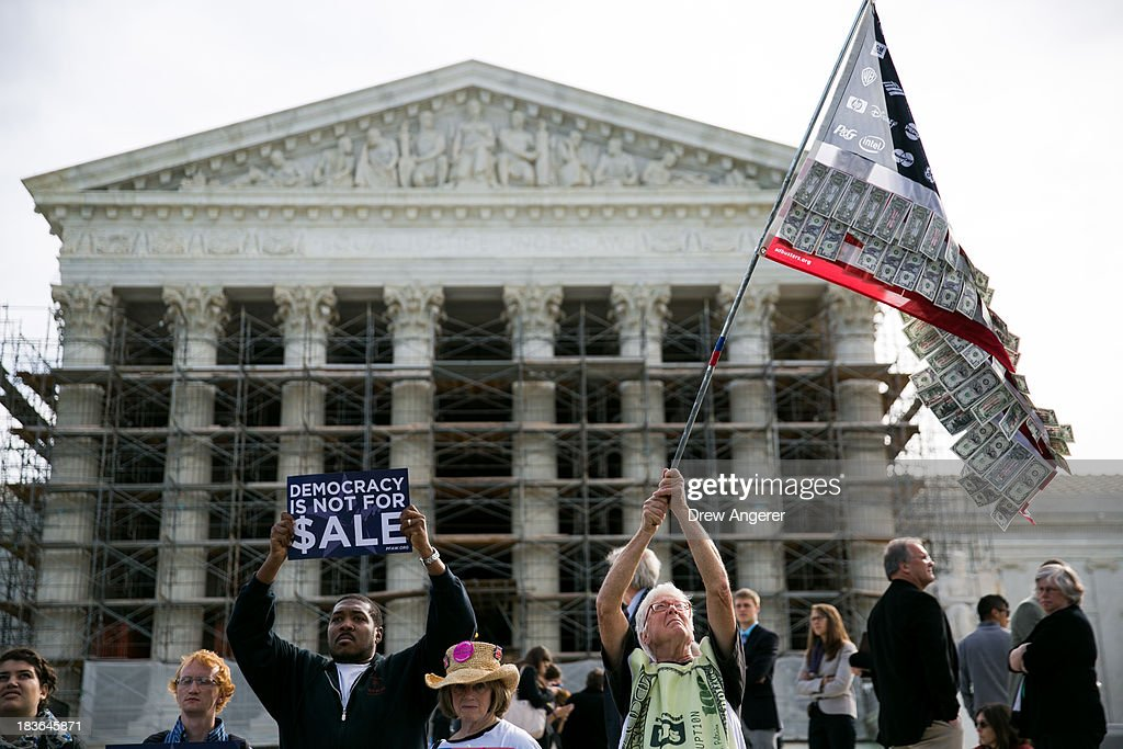Activists gather in front of the Supreme Court during a rally against money in politics, in Washington, on October 8, 2013 in Washington, DC. On Tuesday, the Supreme Court heard oral arguments in McCutcheon v. Federal Election Committee, a first amendment case that will determine how much money an individual can contribute directly to political campaigns.