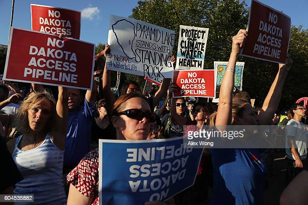 Activists gather in front of the White House during a rally against the Dakota Access Pipeline September 13 2016 in Washington DC Activists held a...