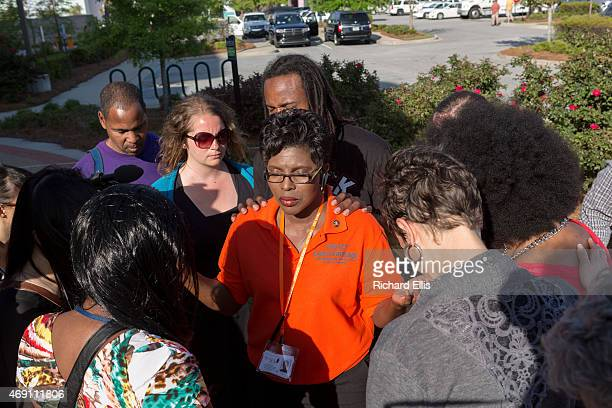 Activists gather outside the City Hall to hold a prayer gathering on April 9 2015 in North Charleston South Carolina The City Council held their...