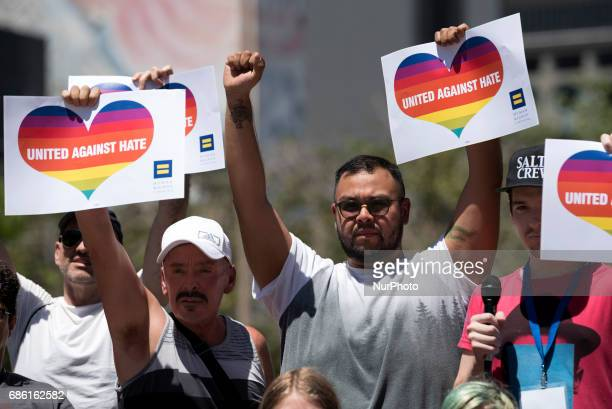 Activists gather to protest the reported detention and deaths of gay men and trans women in Chechnya Los Angeles California on May 20 2017