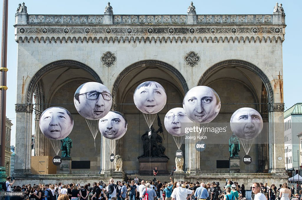 Activists have installed balloons decorated with the portraits of (L-R) Japanese Prime Minister Shinzo Abe, French President Francois Hollande, Italian Prime Minister Matteo Renzi, German Chancellor Angela Merkel, Canadian Prime Minister Stephen Harper, British Prime Minister David Cameron and US President Barack Obama during a protest activity against the G7 summit on June 5, 2015 in Munich, Germany. Germany will host the G7 summit at Elmau Castle near Garmisch Partenkirchen, southern Germany, on June 7 and June 8, 2015.