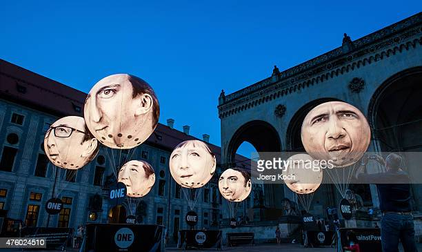 Activists have installed balloons decorated with the portraits of French President Francois Hollande British Prime Minister David Cameron Japanese...