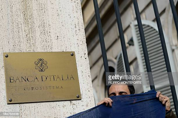 Activists hold a banner after occupying the European System of Central Banks and eurosystem offices of the Bank of Italy to protest against the...