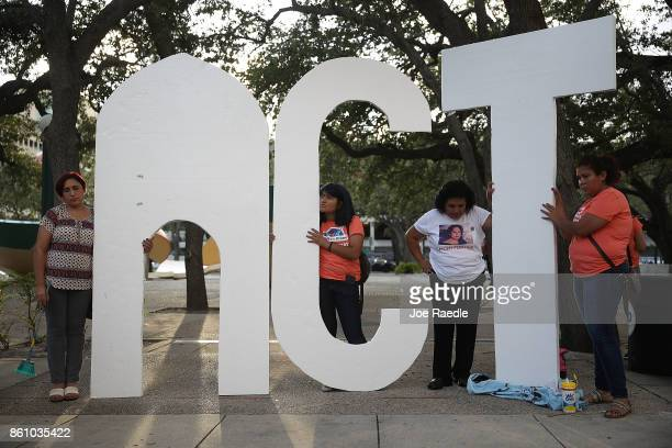 Activists hold a sign that reads 'Act' as they gather together to ask Sen Marco Rubio to cosponsor a 'clean' Dream Act which would give permanent...