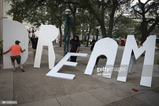 Activists hold a sign that reads 'Dream' as they gather together to ask Sen Marco Rubio to cosponsor a 'clean' Dream Act which would give permanent...