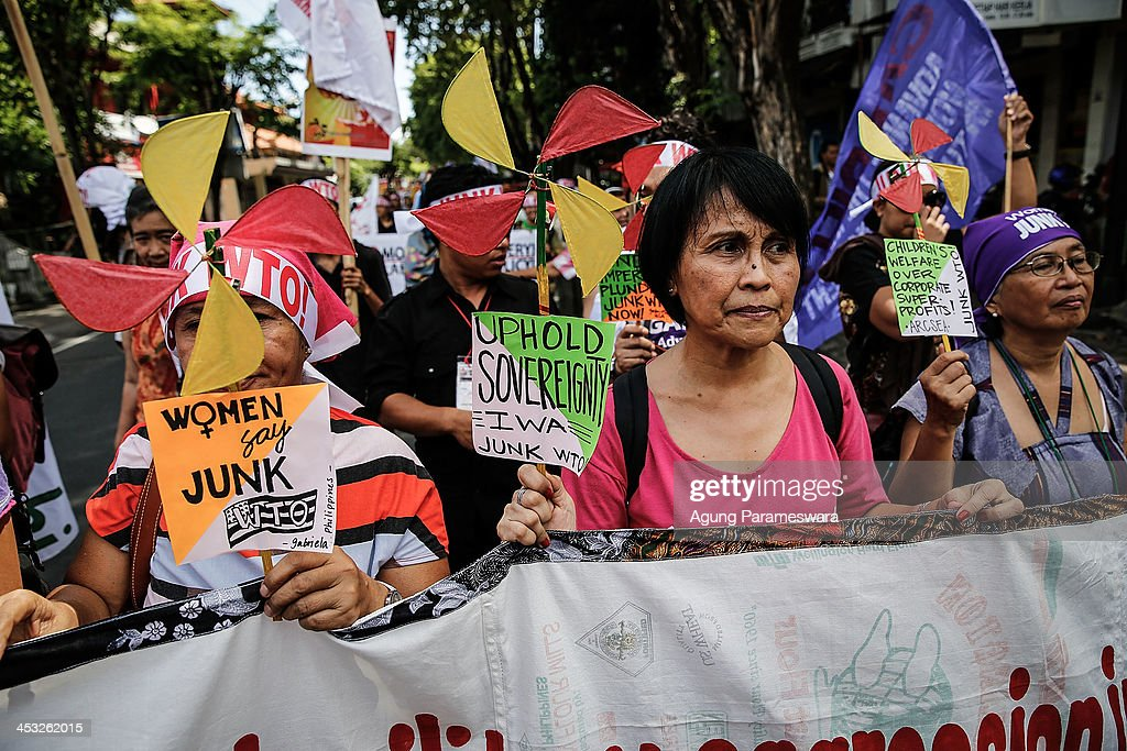 Activists hold banners during a protest against the World Trade Organization meeting on December 3 2013 in Denpasar Indonesia Thousands of farmers...