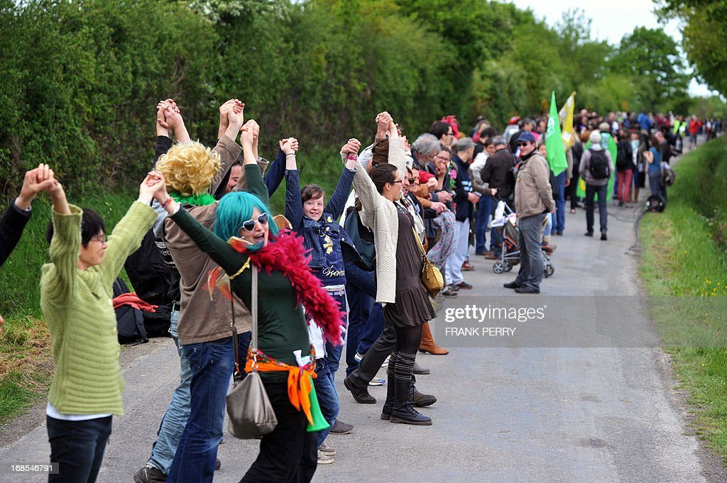Activists hold hands and form a human chain as they take part in a protest against the construction of a new airport in Notre-Dame des Landes, on May 11, 2013. Several thousand protesters, at least 5 000 according to the local police department, gathered for the demonstration.