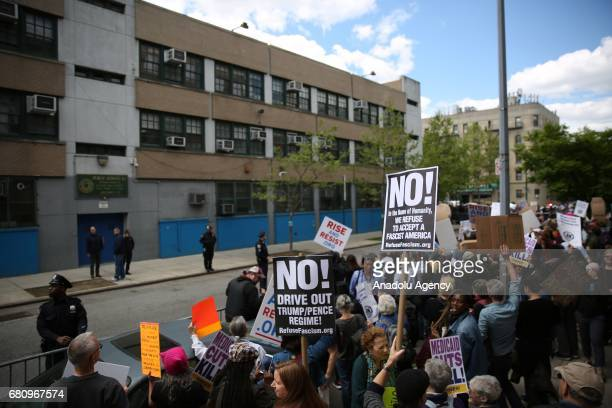 Activists hold signs as they chant slogans against Paul Ryan speaker of the United States House of Representatives visit to Harlem Success Academy...