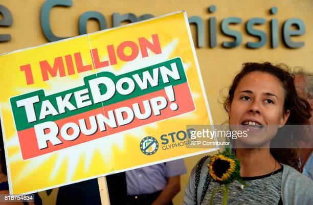Activists hold signs as they demonstrate in favor of a Glyphosate ban by the European Union in front of the European Union Commission headquarter in...