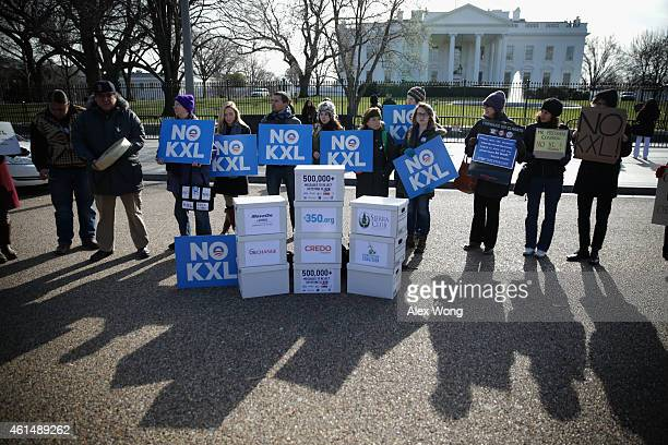 Activists hold signs as they protest in front of the White House against the Keystone XL pipeline January 13 2015 in Washington DC Activists staged...