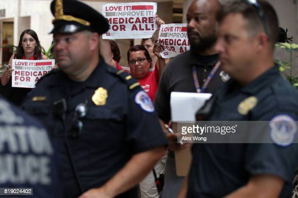 Activists hold signs in a protest against the Republican health care repealandreplace legislation at the Hart Senate Office Building on Capitol Hill...