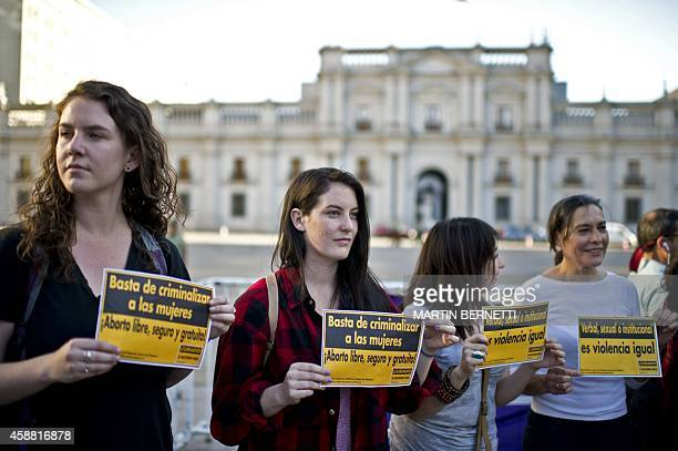 Activists hold signs reading 'Stop criminalizing women Free and safe abortion' and 'Verbal sexual or institutional it is violence anyway' as they...