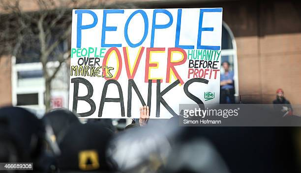 Activists hold up a banner during a demonstration organized by the Blockupy movement to protest against the policies of the European Central Bank...