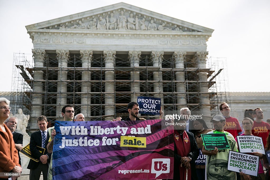 Activists hold up a banner during a rally against money in politics, at the Supreme Court in Washington, on October 8, 2013 in Washington, DC. On Tuesday, the Supreme Court heard oral arguments in McCutcheon v. Federal Election Committee, a first amendment case that will determine how much money an individual can contribute directly to political campaigns.