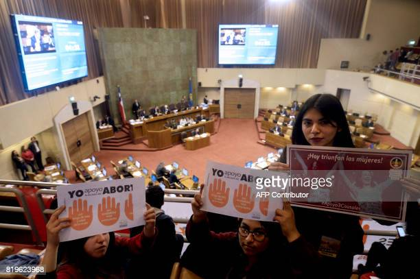 Activists holding placards supporting abortion take part in a proabortion demonstration held inside the National Congress in Valparaiso Chile on July...