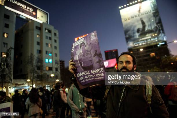 Activists holding placards supporting abortion take part in a proabortion demonstration in Santiago on July 25 2017 A plan to ease a ban on abortion...