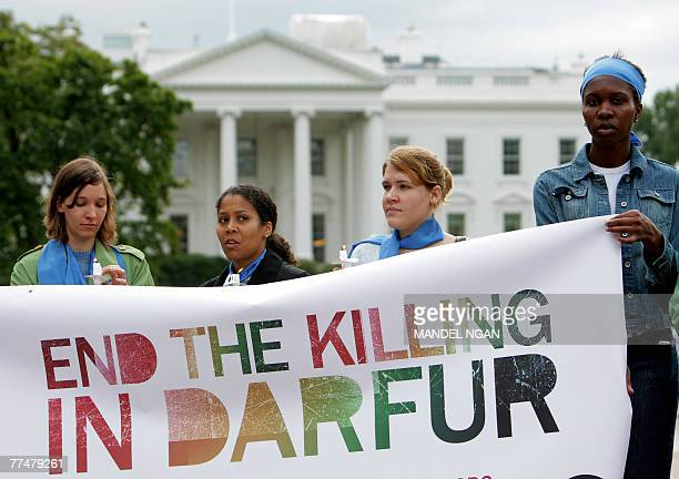 Activists holds a banner across from the White House during a rally and vigil for the people of Sudan's Darfur region 24 October 2007 in Lafayette...